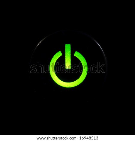 Glowing power button on black background