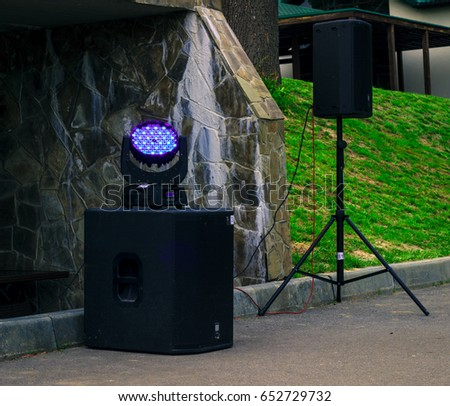 Glowing projector for color music glows in the open air #652729732