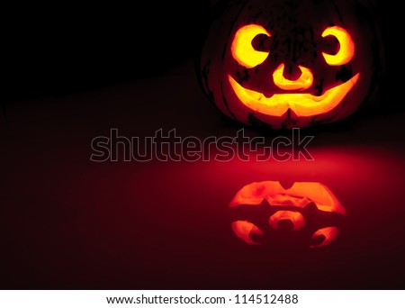 Glowing pumpkin with a candle inside. Decorations for Halloween.