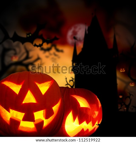 Glowing pumpkins in a dark scary forest with cemetery