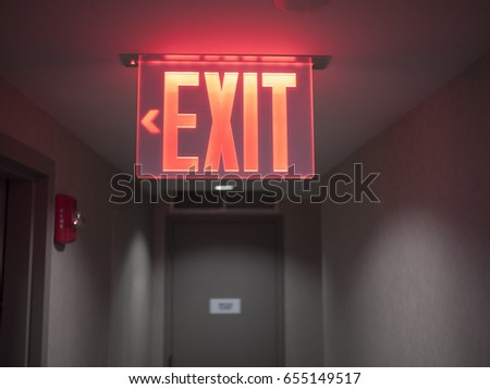 glowing red exit sign.