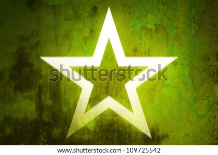Glowing star abstract on urban wall - stock photo