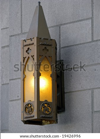 glowing wall lamp lantern on church exterior