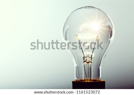 Glowing yellow light bulb, busienss idea concept #1161523072