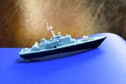 Glued and hand painted toy made of plastic. Small vessel - corvette wirh rockets, Russian ship.