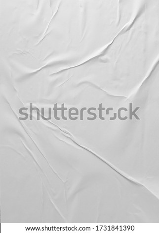 Glued paper for poster texture. Blank white crumpled and wrinkled paper template for background. Matted wet paper wrinkled for mockup posters