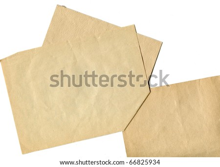 glued together sheets of yellowed old paper  isolated on white background