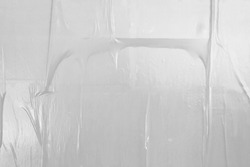 glued wall white poster paper with air pockets and bumpy uneven application