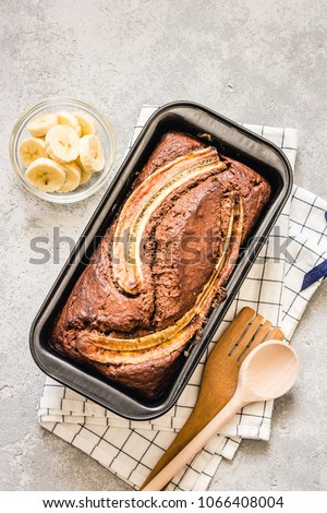 Gluten free, dairy free banana bread on light concrete background. Selective focus, space for text. #1066408004
