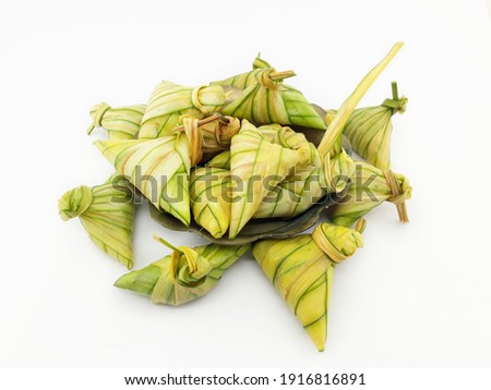 Glutinous rice wrapped with leave on white background. Also known as Ketupat Palas. Served during eid festival by muslim in Malaysia. Foto stock ©