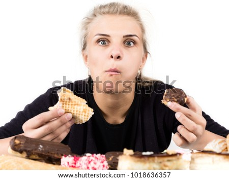 glutton woman eating cupcakes with frenzy after long diet