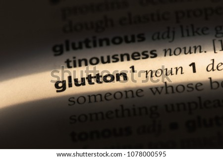 glutton word in a dictionary. glutton concept