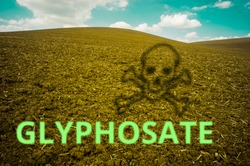 Glyphosate as text with a shadow of a scull and crossbones on a agriculture field