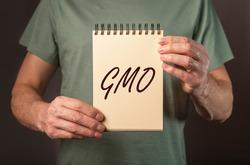 GMO acronym. Inscription on paper. genetically modified organism.