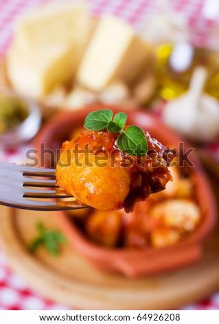 Gnocchi di patata, italian potato noodle with sauce bolognese