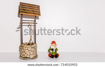 Gnome winks after repairing wishing well. #714010903