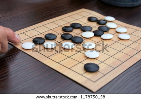 Free Photos Igo Chinese Board Game With Black And White Stone Delectable Game With Stones And Wooden Board