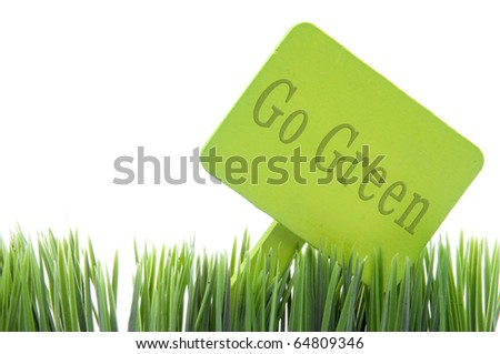 Go Green  sign in fresh grass isolated on a white background.
