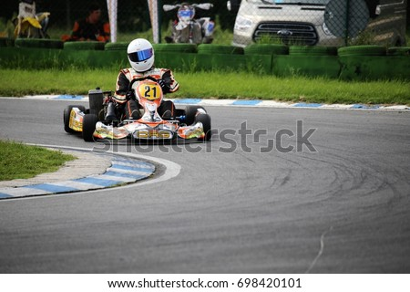 Go-Kart driver on the circuit in Walldorf, Baden-Wurttemberg (Germany), 08/17/17