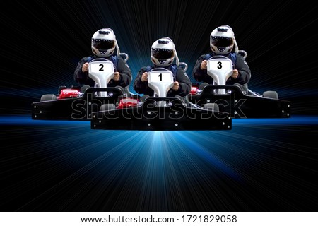 Go kart indoor, cart racing fast, car where gokarting, we speed racing, racers banner. Three riders Go kart speed rive indoor racing on a blue background with rays. Copy space. Photo stock ©