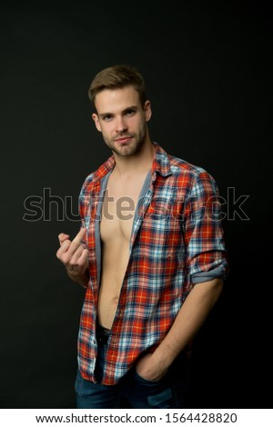 Go to hell. Handsome rude boy. Sexy macho. Brutal guy. Attractive man confident face show middle finger brutal gesture. Masculine traits concept. Male fashion and beauty. Brutal behavior. Expression.