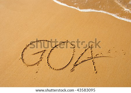 "Goa in India is a beautiful beach town. ""Goa"" written out on the beach"