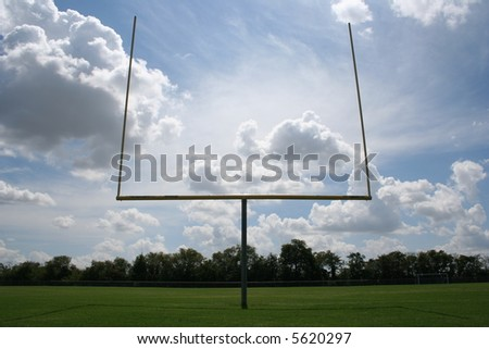 Goal post against fantastic clouds