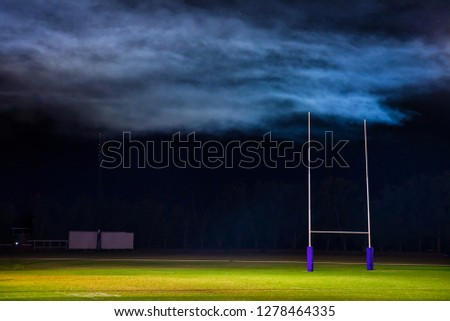 Goal posts for football, rugby union or league on field at night. Dark edit space #1278464335