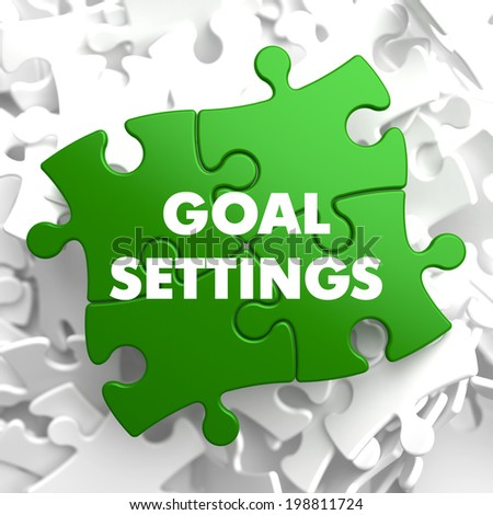 Goal Settings on Green Puzzle on White Background.