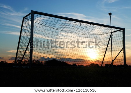 Goal shot from the corner in the front with the sunset