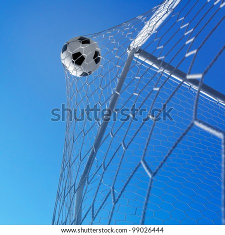 Goal. Soccer ball in net.