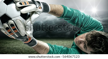 Goalkeeper catches the ball, at the stadium
