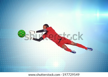 Goalkeeper in red making a save against technical screen with pixels