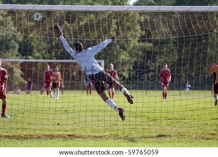 Goalkeeper jumping during a soccer mach
