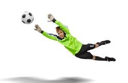 goalkeeper kid flying for the ball isolated on white