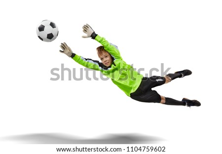 goalkeeper kid flying for the ball isolated on white