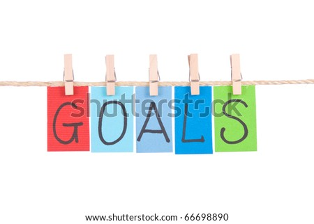 Goals, Colorful words hang on rope by wooden peg