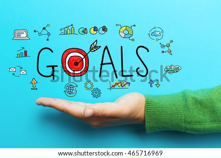 Goals concept with hand on blue background #465716969