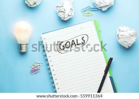 goals text on notebook with idea on blue background #559911364
