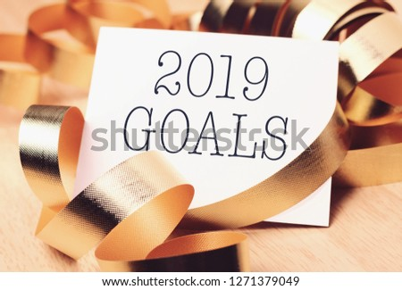 Goals 2019 with gold decoration. Discover how setting goals can bring more happiness in your life. #1271379049