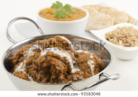 Goan Chicken Xacuti drizzled with coconut milk served with pilau rice, tarka dahl and chapatis