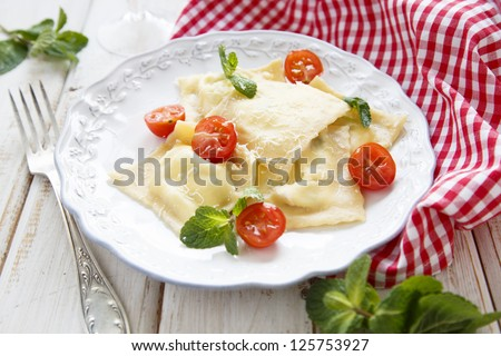 Goat cheese and mint ravioli with cherry tomatoes