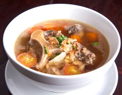 Goat soup is a mutton soup dish commonly found in Indonesia.This dish is made from goat meat, tomatoes, celery, leeks, ginger, candlenut and orange leaves, the broth is a clear yellowish-colored