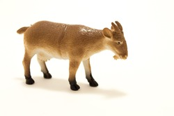 Goat toy made of plastic on a white background
