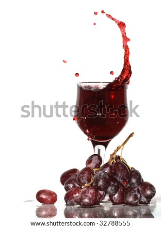 Goblet with splashing red wine standing near bunch of grapes. Isolated with clipping path