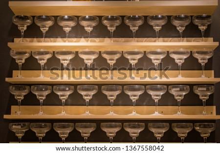 goblets on shelves. glass goblets on shelves. decorative goblets. #1367558042