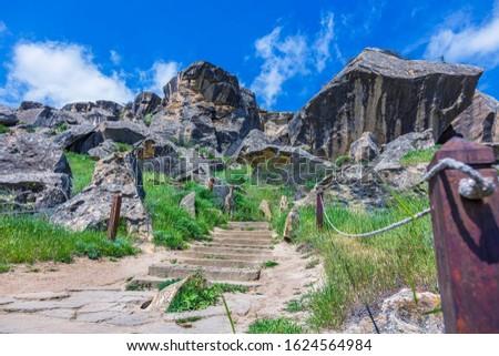 Gobustan, Azerbaijan - April 16, 2019: Gobustan National Park near the old rocks, rock road and mountains Azerbaijan Baku. Azerbaijan Gobustan Petroglyphs Fair near Baku.