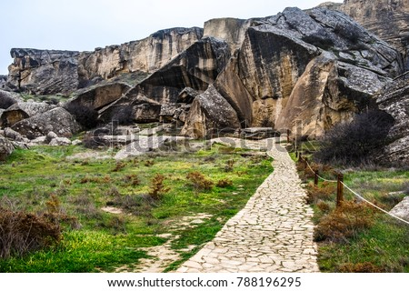 Gobustan national park ancient rocks, rock path and mountains near Baku in Azerbaijan. Exposition of Petroglyphs in Gobustan near Baku, Azerbaijan.