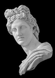 God Apollo bust sculpture. Ancient Greek god of Sun and Poetry Plaster copy of a marble statue isolated on black