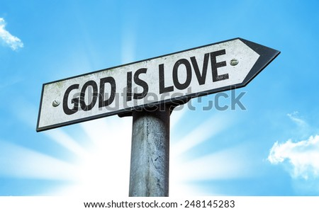 God is Love sign with a beautiful day